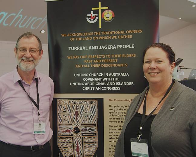 Stu and Colleen with Covenanting banner at Qld Synod